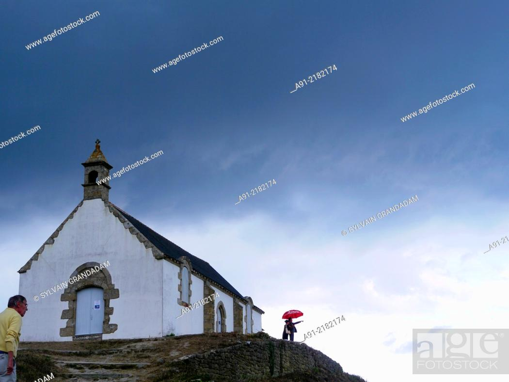 Stock Photo: France, Brittany, Carnac village, famous for its lined rocks and church.