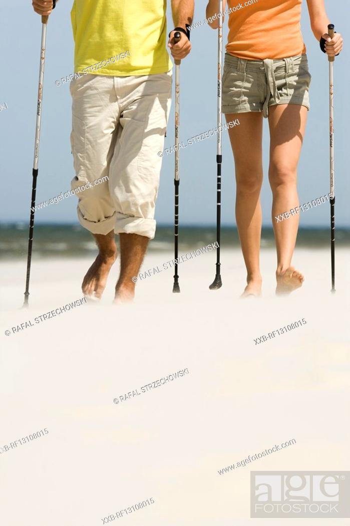 Stock Photo: couple hiking on beach.