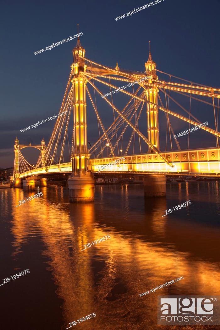 Stock Photo: Albert Bridge on the river Thames, connecting Chelsea and Battersea on the south , London, England.4, 000 bulbs illuminate Albert Bridge at night.