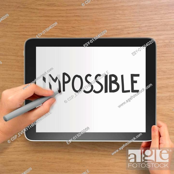 Stock Photo: hand changing the word impossible to possible with stylus eraser.