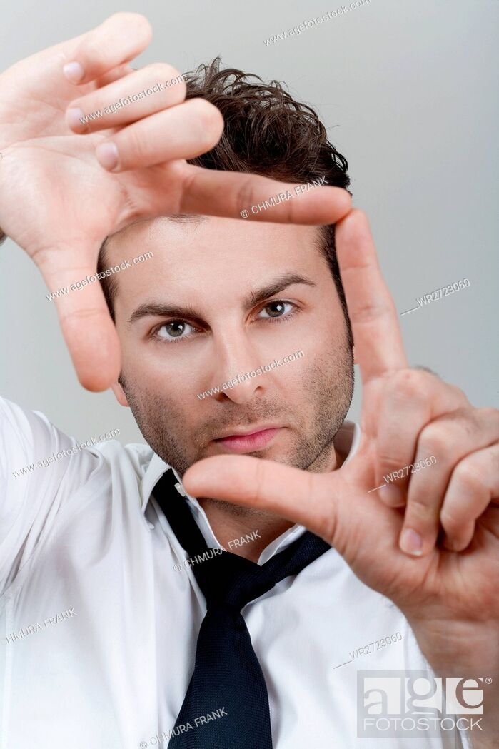 Stock Photo: adult, background, business, businessman, Caucasian, composition, concept, creative, creativity, director, executive, expression, eyes, face, finger, fingers.