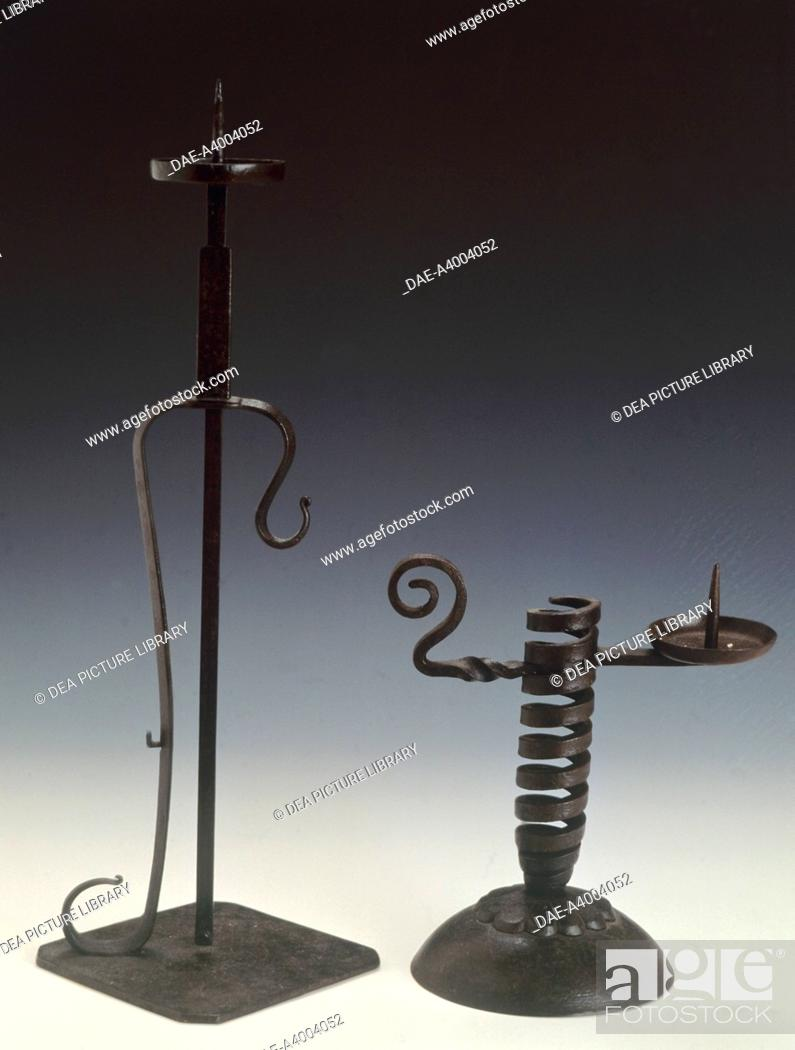 Stock Photo: artefact A: height adjustable candlestick (shokudai), 19th century, cast iron, height 39.5 cm. artefact B: Height adjustable spiral candlestick (shokudai).