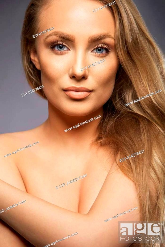 Stock Photo: Beautiful model with blond hair looking at camera.