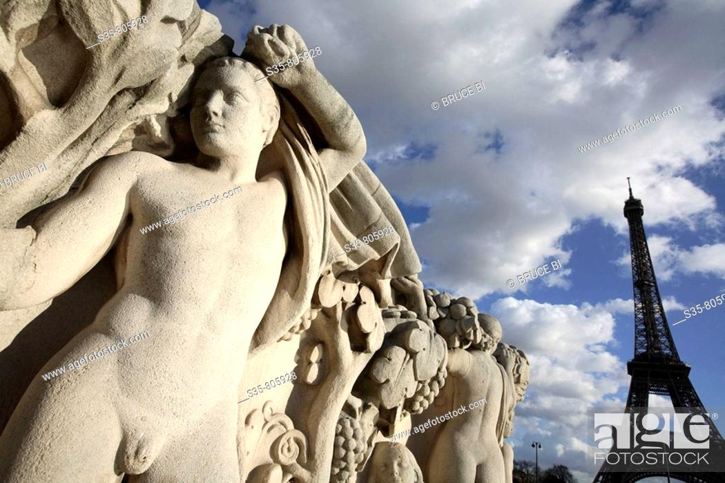Stock Photo: Stone sculptures at the base of the Chaillot pool with Eiffel Tower in background, Paris. France.