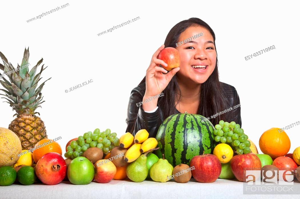 Stock Photo: Many fruits stacked together and cute girl.