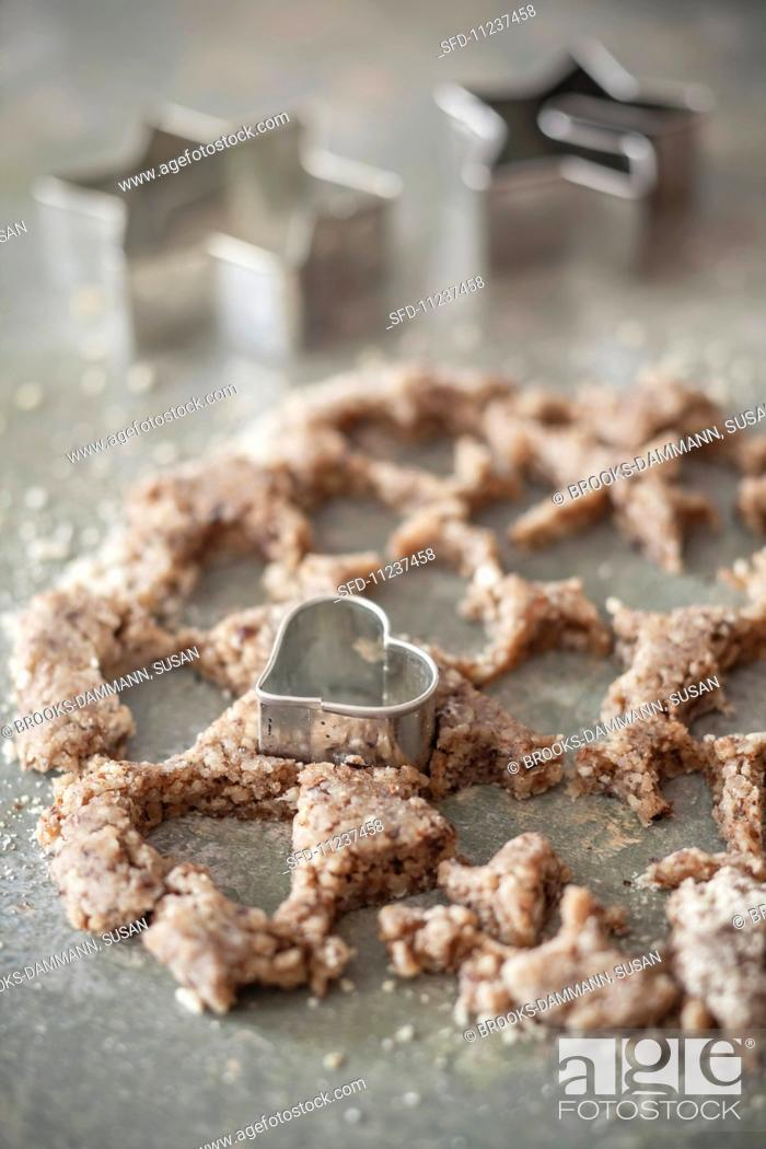 Stock Photo: Leftover biscuit dough after cutting out biscuits, with a heart-shaped cutter.