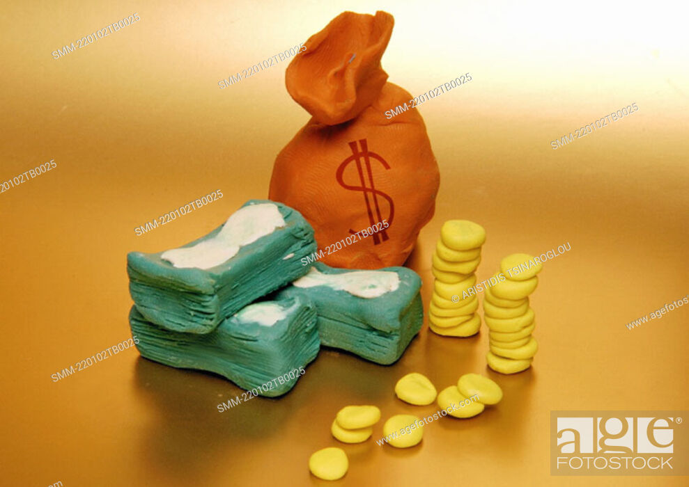 Stock Photo: A bag of money with bills and coins next to it.