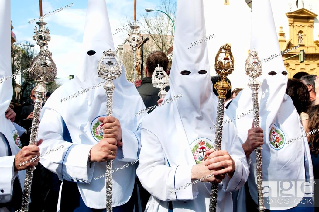 Stock Photo: Three Nazarenes in the Holy Week in Seville.