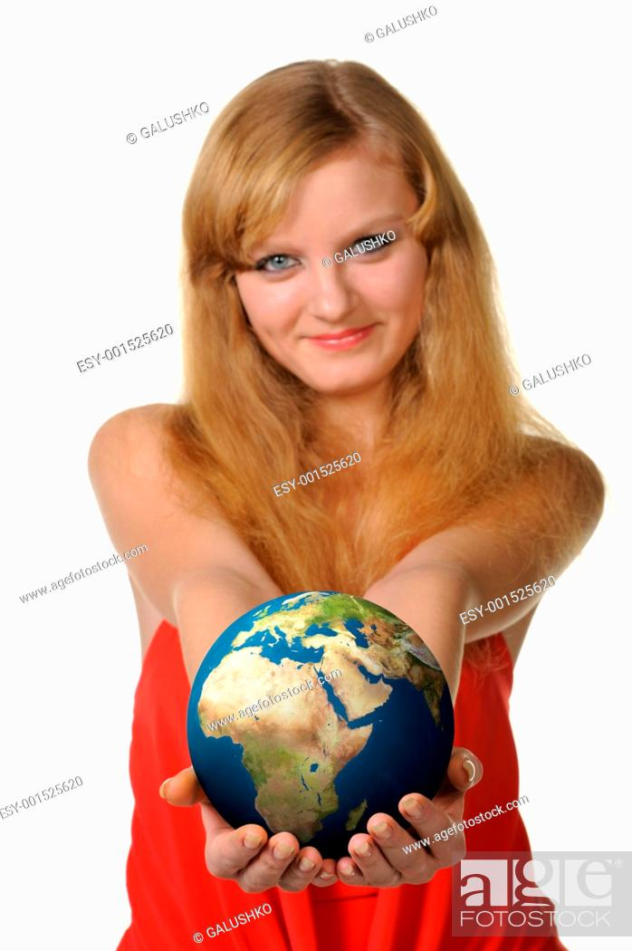 Stock Photo: The young woman holds the globe in hands.