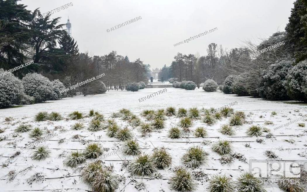 Stock Photo: Parco Sempione in Milan, Lombardy, Italy covered in snow. Arco Della Pace, translated to Peace Arch, in the far background.