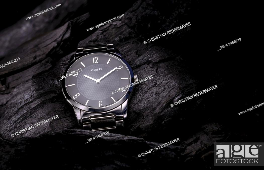 Stock Photo: life style watch on black coals as background.