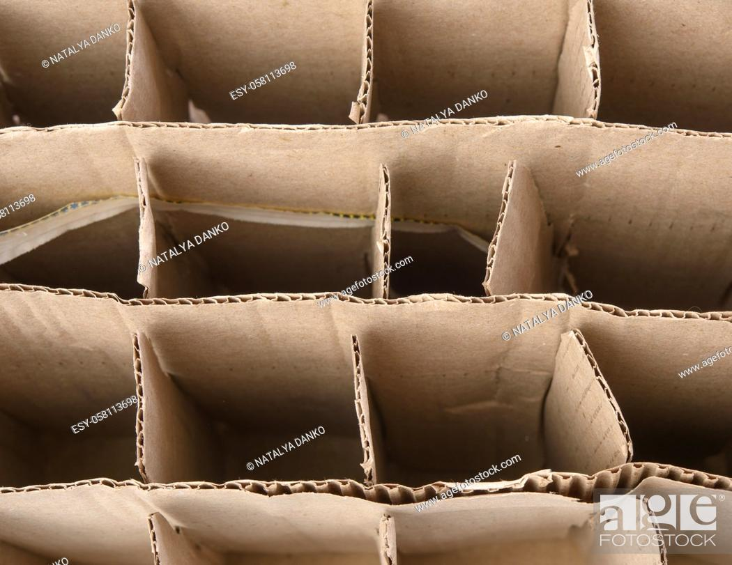 Stock Photo: brown corrugated paper cardboard box with partitions, glass bottle transport box, close up.
