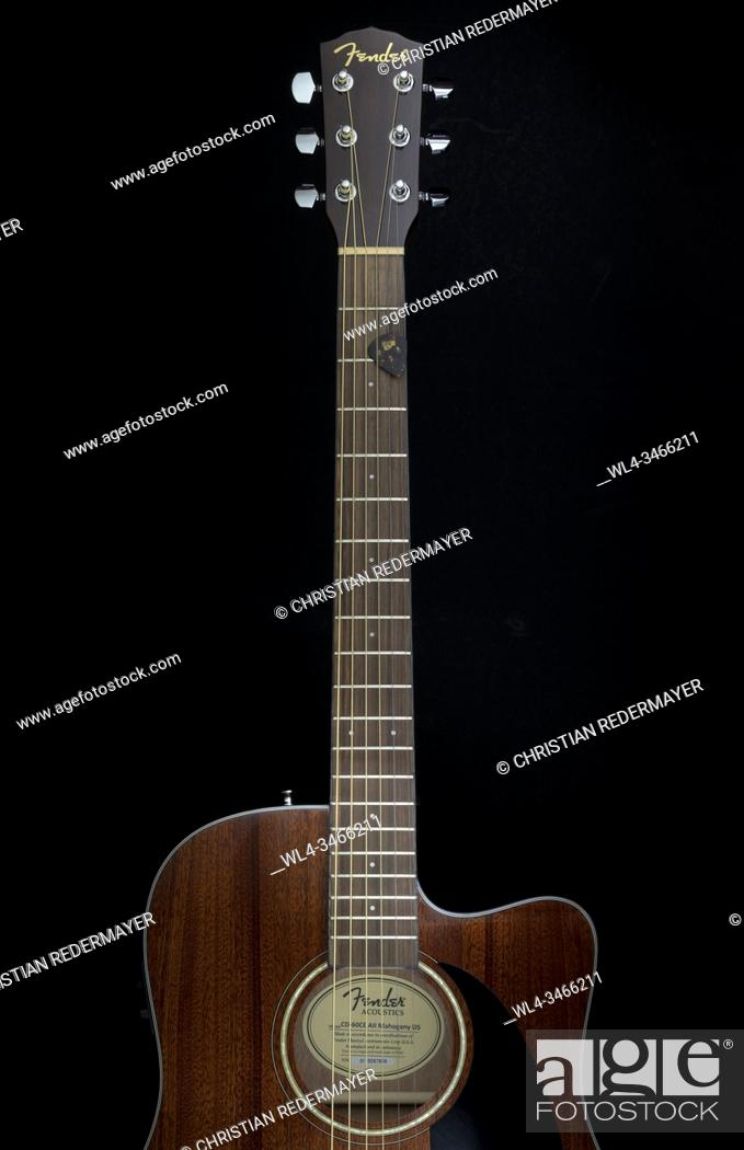 Stock Photo: A classic guitar on a black background painted with light show the elegance of the curves.