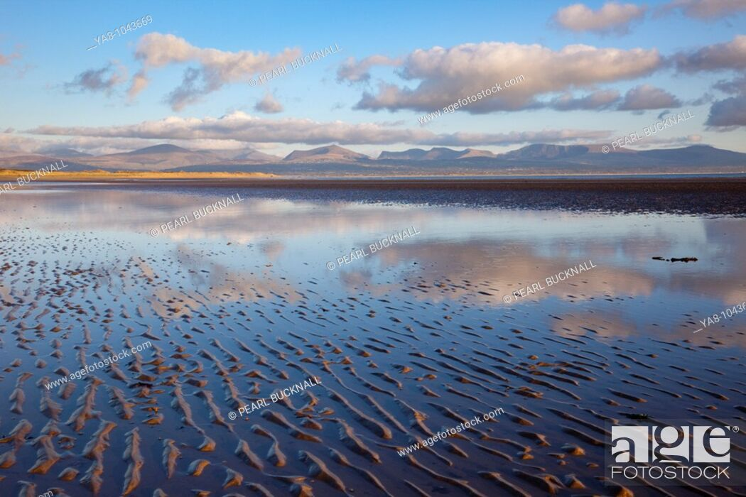Stock Photo: Newborough, Anglesey, North Wales, UK, Europe  Tidal pool reflecting clouds on Traeth Llanddwyn conservation beach in National Nature Reserve in early evening.