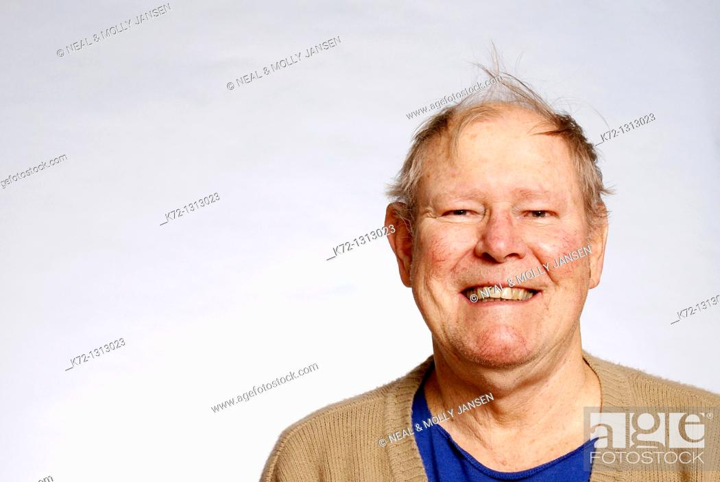 Stock Photo: Elderly man with funny hairdo.