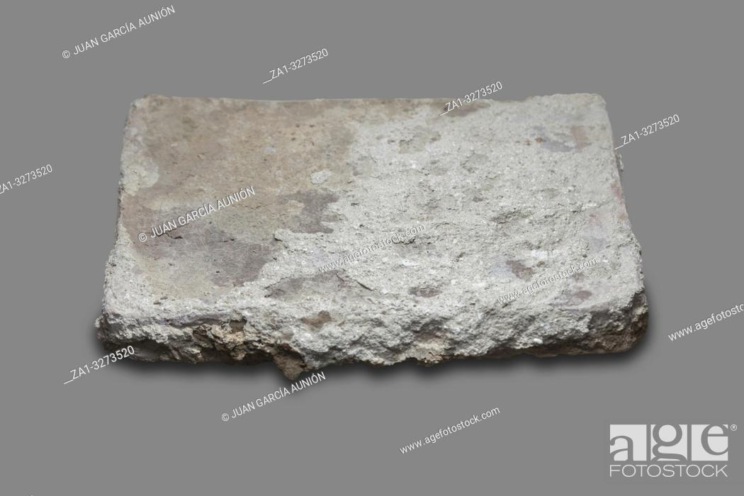 Imagen: Roman flat-shaped brick. Isolated over gray background.