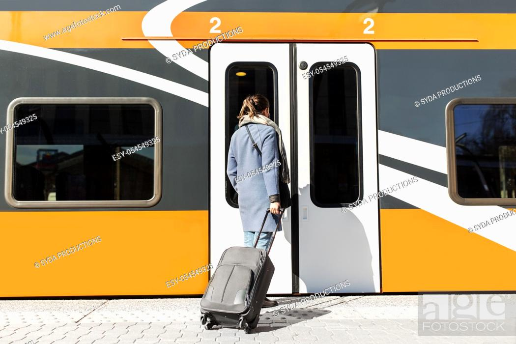 Stock Photo: woman with suitcase at railway station.