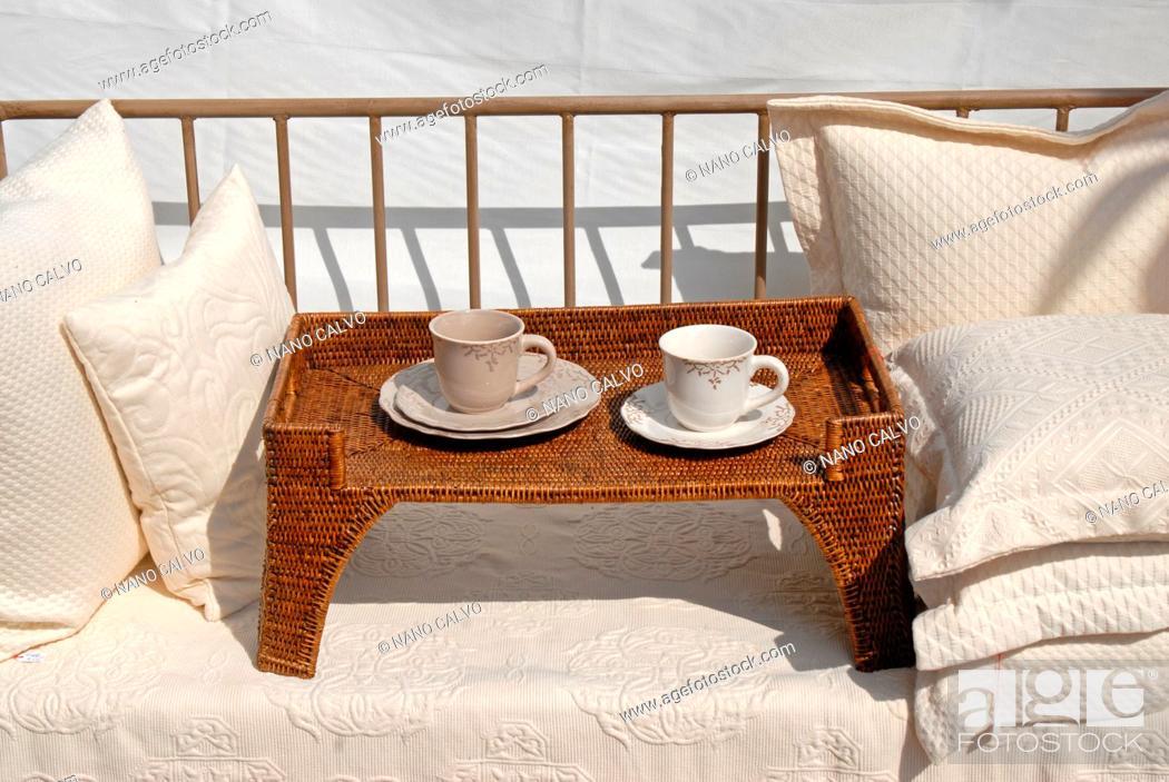 Stock Photo: Terrace sofa and tea cups.