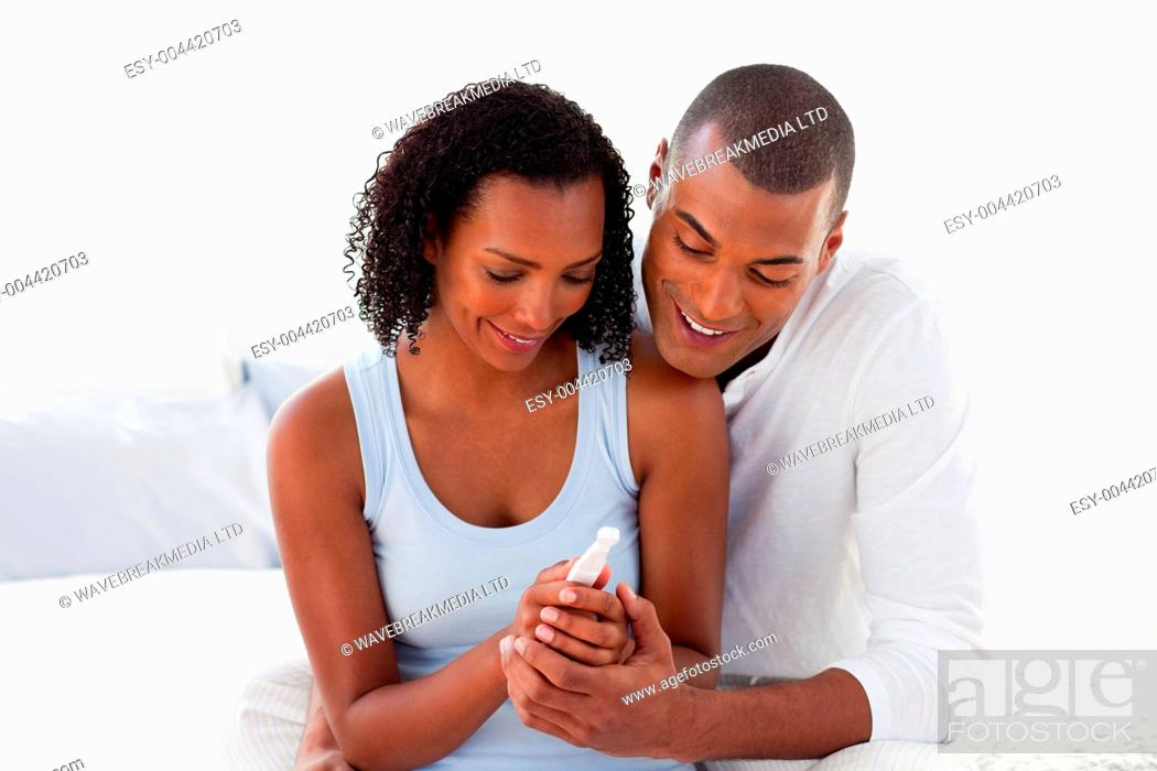 Stock Photo: Happy couple finding out results of a preg ncy test.
