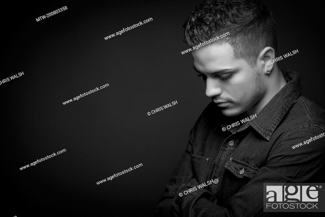 Imagen: Black and white portrait teenage boy serious sad.