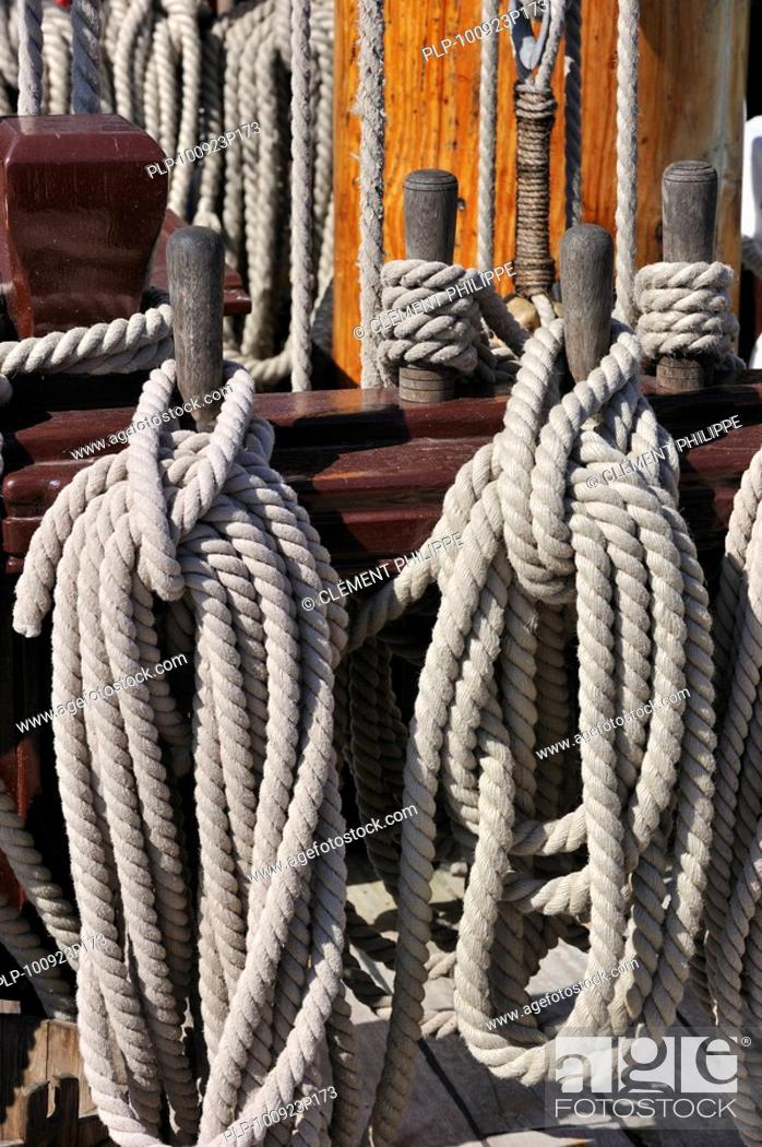Stock Photo: Ropes coiled around belaying pins aboard the Grand Turk / Etoile du Roy, a three-masted sixth-rate frigate replica of HMS Blandford.