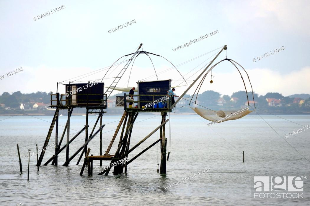 Stock Photo: Traditional carrelet lift net fishing hut. Saint-Michel-Chef-Chef beach, Loire-Atlantique, France. Plaice smelt squid sole eel.