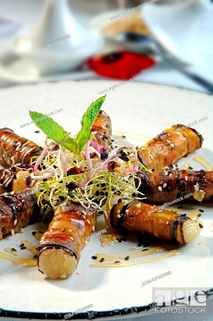 Photo de stock: Aubergine rolls with rosemary honey.