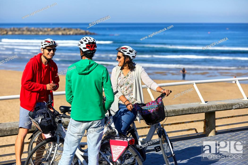 Stock Photo: Group of tourists and guide making a bicycle tour through the city, Zurriola Beach, Gros, Donostia, San Sebastian, Gipuzkoa, Basque Country, Spain, Europe.