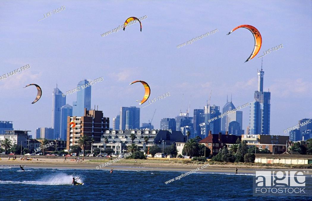 Stock Photo: Kite surfing on St. Kilda beach in front of the skyline of downtown Melbourne, Victoria, Australia.