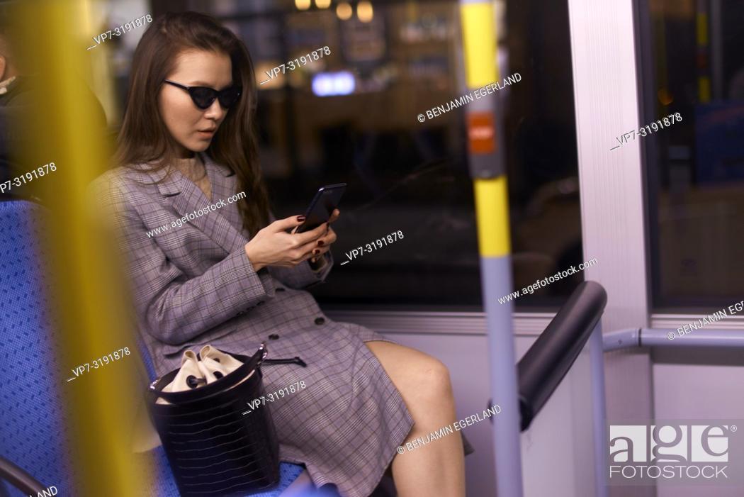 Imagen: Woman in tram by night. Munich, Germany.