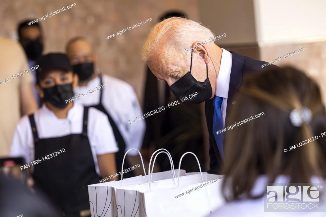 Stock Photo: United States President Joe Biden picks up tacos during a visit to Las Gemelas Restaurant in Washington, DC, USA, 05 May 2021.