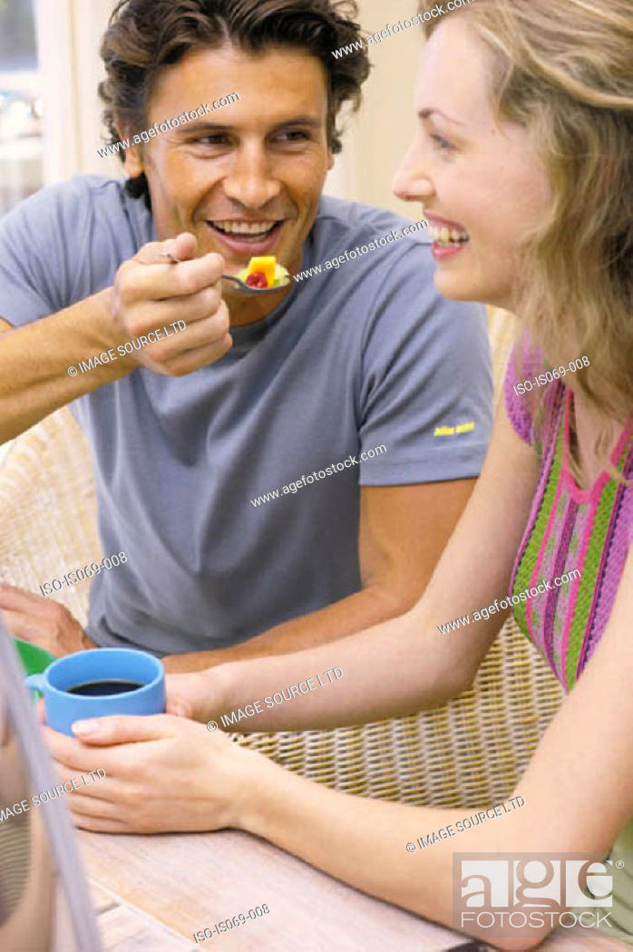 Stock Photo: Couple at breakfast.