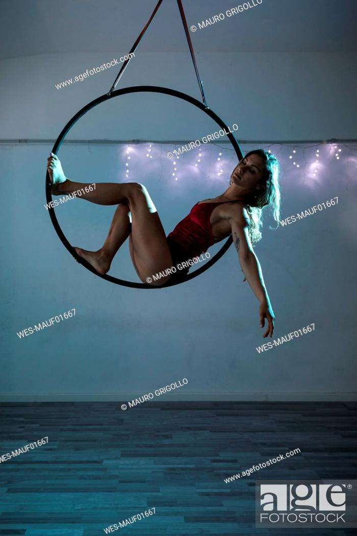 Stock Photo: Female artist during a performance with hoop.