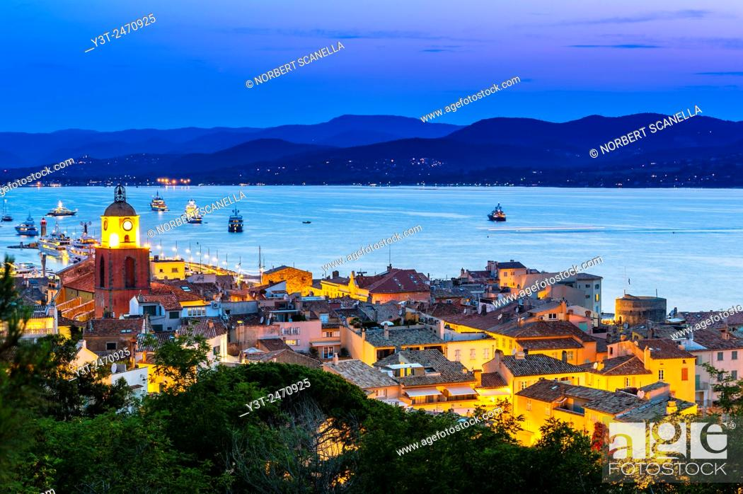 Stock Photo: Europe, France, Var, Saint-Tropez. The parochial church in the village and the Gulf of Saint-Tropez by night.