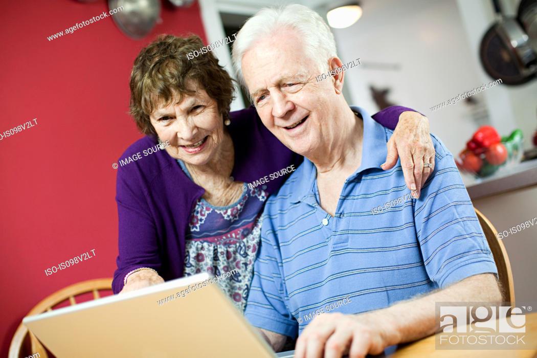 Stock Photo: Senior couple using laptop.