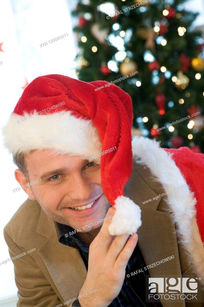 Stock Photo: man in santa hat.