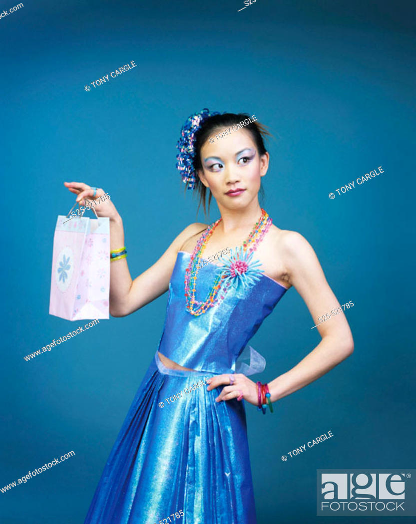 Stock Photo: Asian Woman in Skirt & Top made from Wrapping Paper, MR #1056.