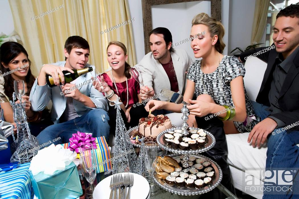 Stock Photo: Young woman celebrating birthday with her friends.