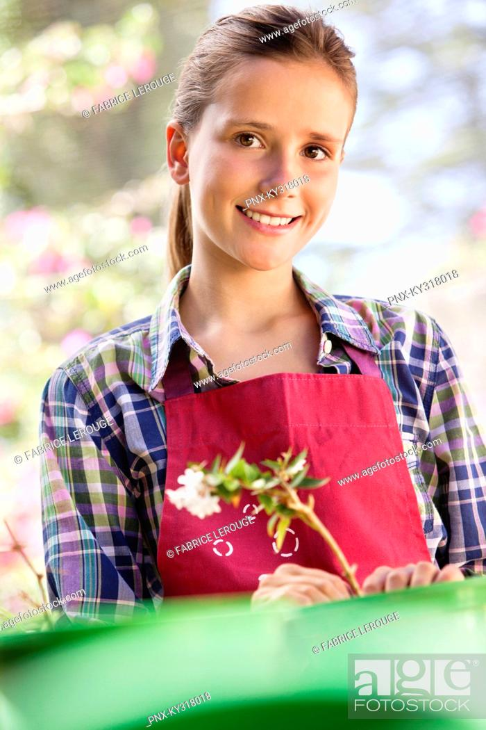 Stock Photo: Portrait of a girl gardening and smiling.