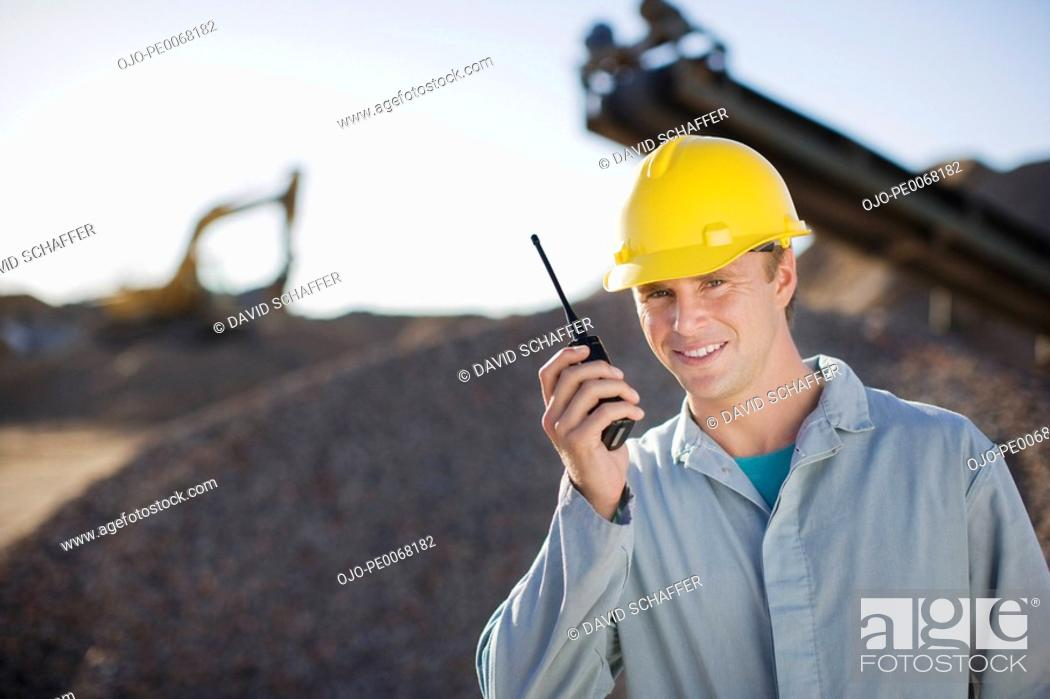 Stock Photo: Construction worker talking into walkie-talkie.