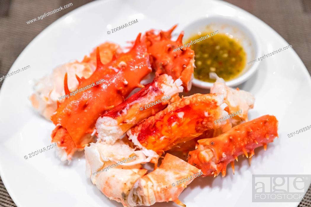 Stock Photo: alaskan king crab and seafood on white dish with seafood sauce.