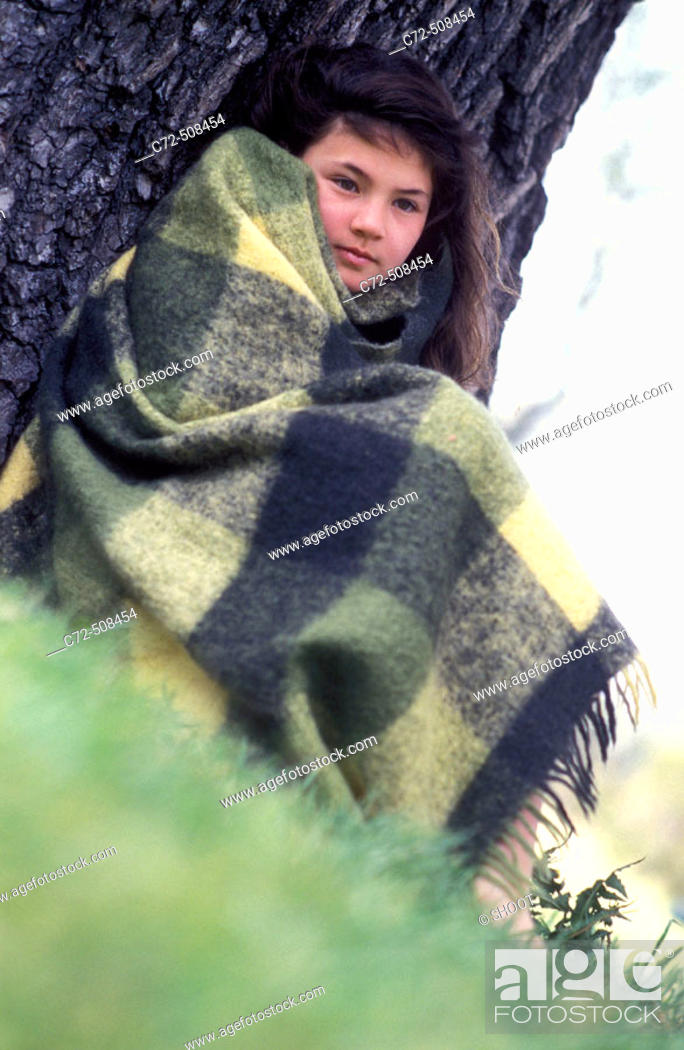 Stock Photo: Girl wrapped in blanket, outdoors.