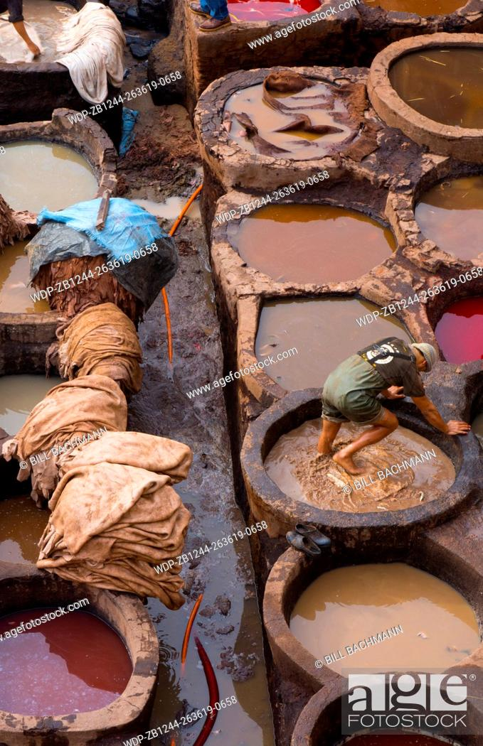 Stock Photo: Fez Morocco old Tannery called Chouara Tannery which is almost 1000 years old from above of tannery vats with color dyes.