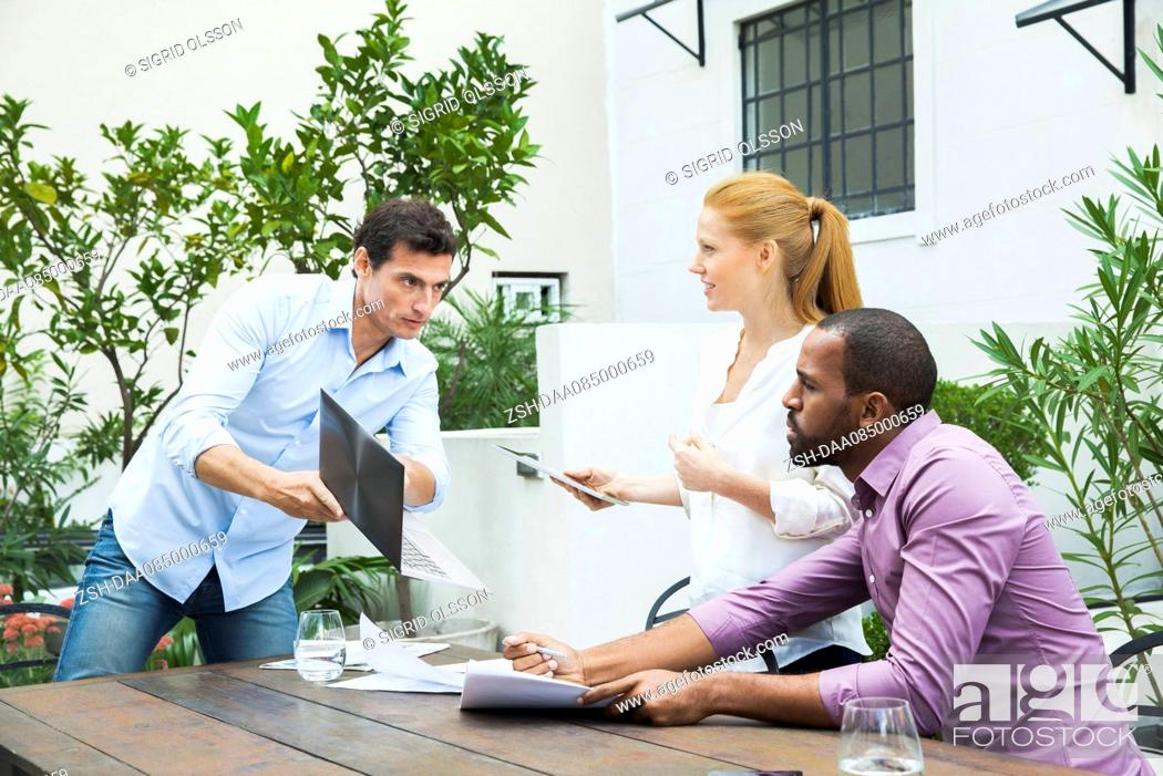 Stock Photo: Businessman sharing good news with colleagues.