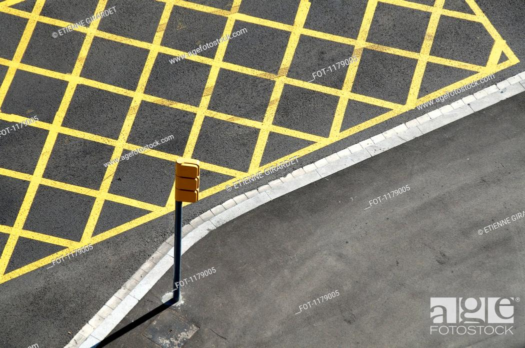 Stock Photo: Yellow lines on the street to mark no-stopping area near a red light/crossing.