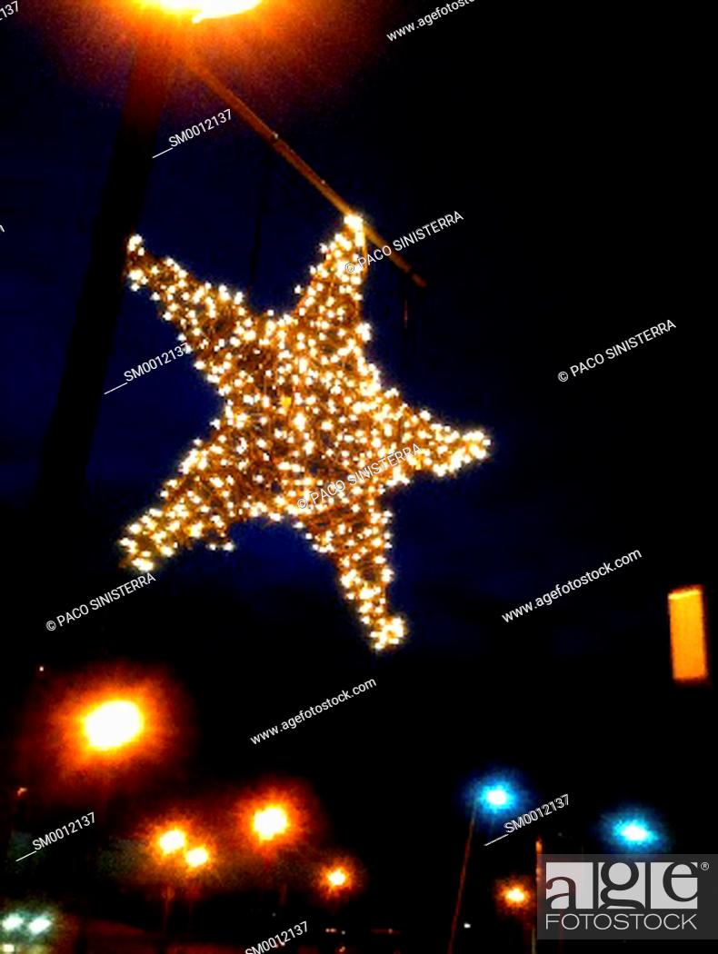Stock Photo: Christmas Ornament, rating on the street with lights, valencia.