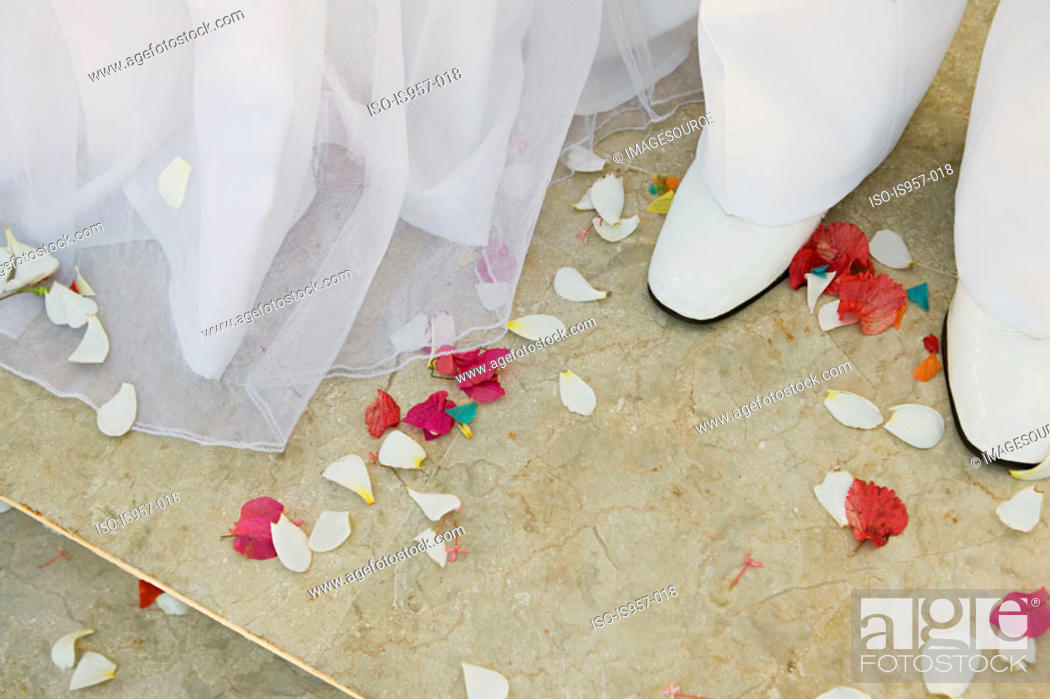 Stock Photo: Confetti around feet of bride and groom.