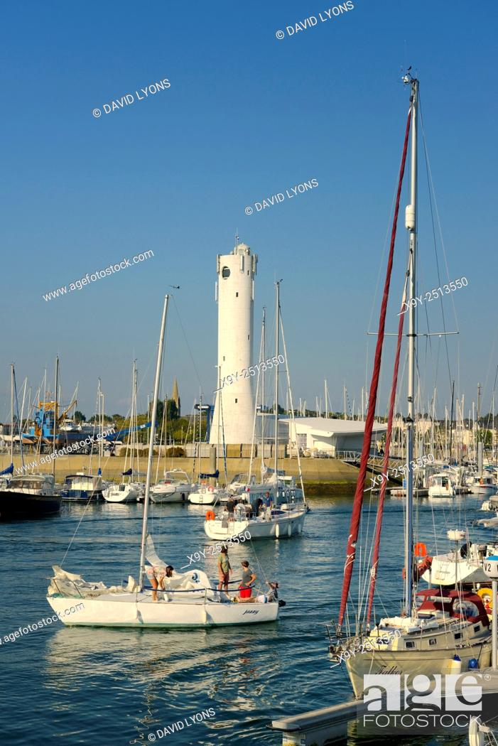 Stock Photo: Pleasure boats yachts in Port du Crouesty marina in Baie de Quiberon, Brittany, France. Looking toward the lighthouse.