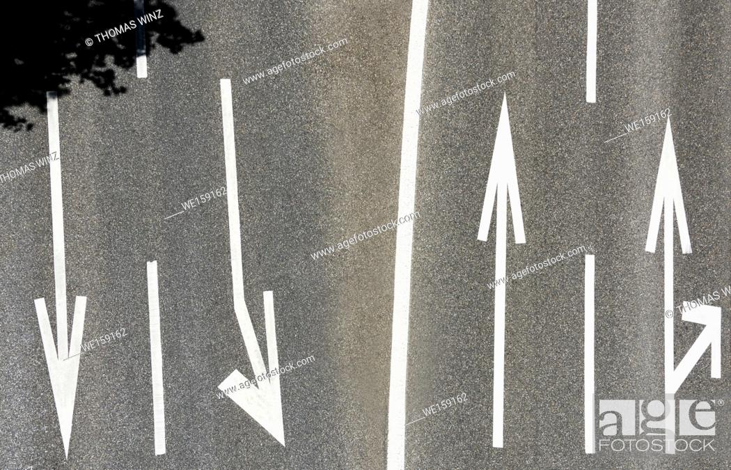 Stock Photo: Arrows painted on street pavement , looking straight down, Zurich, Switzerland.