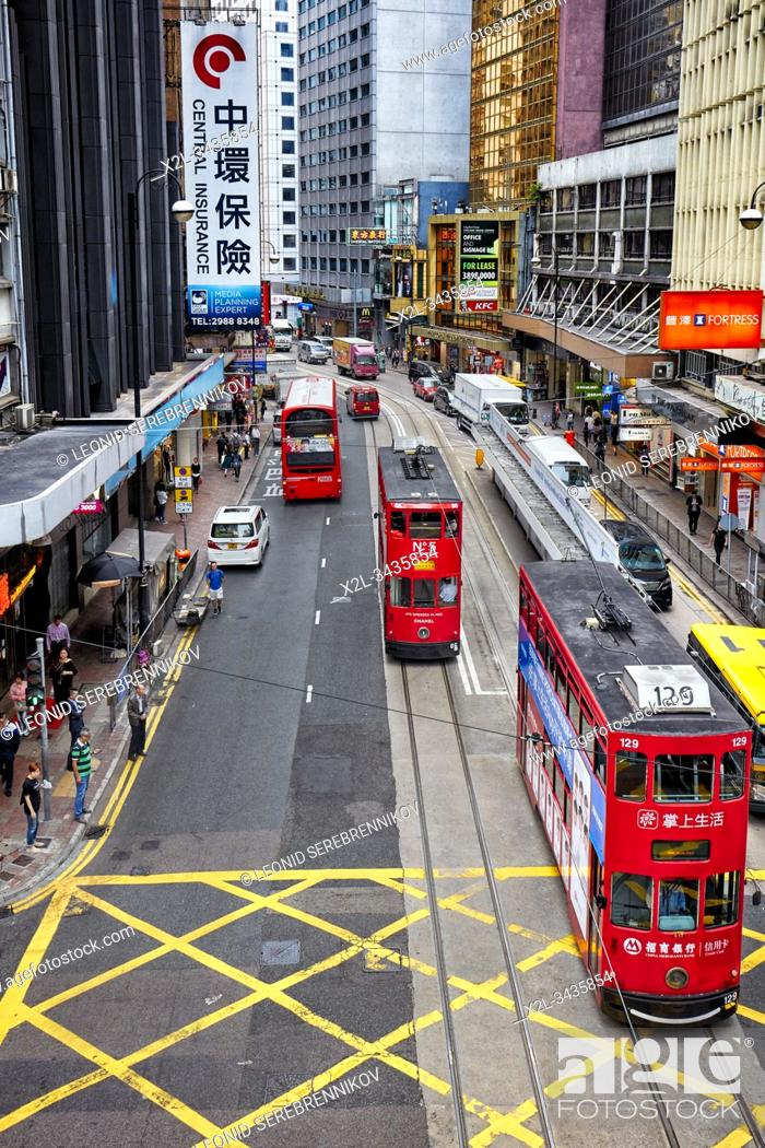 Stock Photo: Double-decker trams on Des Voeux Road Central. Central, Hong Kong, China.